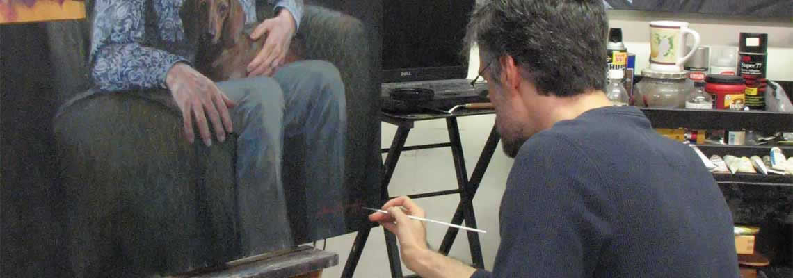 artist applies a signature to a commissioned portrait painting
