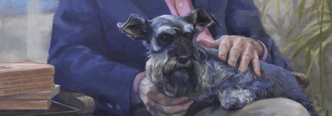Scottish Terrier on the lap of a man