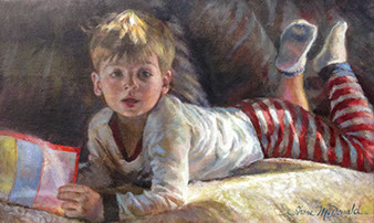 oil portrait of a young boy wearing pajamas laying on his stomach and reading on a couch